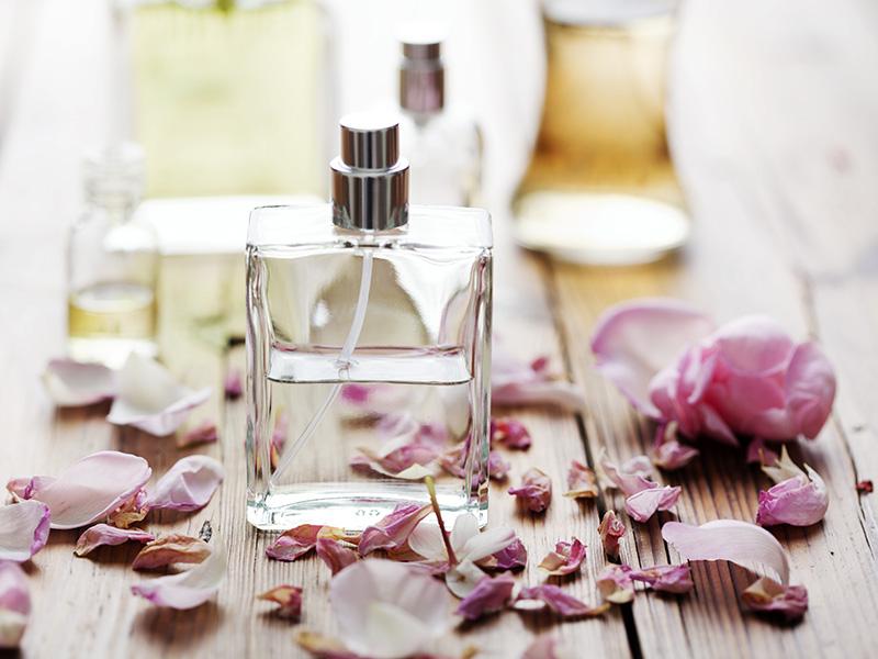 Pefume Bottles With Flower Petals